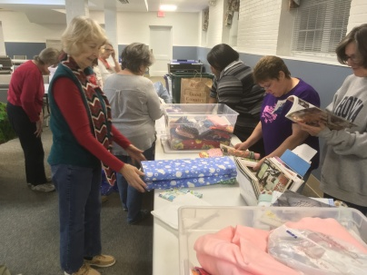 Members browse charity fabrics