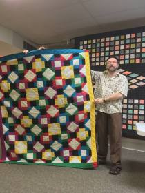 Scott's first quilt made by hand for his daughter