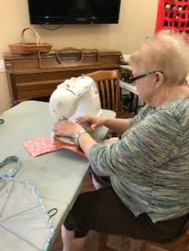 Alamance House resident sewing