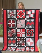 red, black, gray quilt