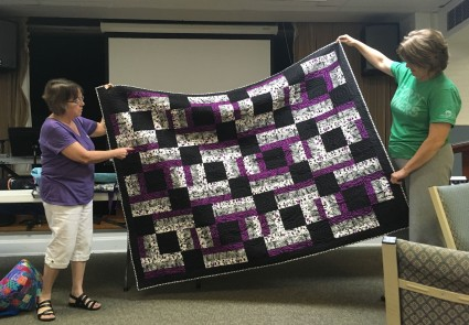 purple and black quilt