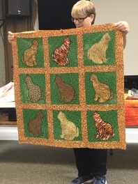 quilt with 9 cats