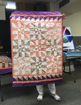 orange and purple quilt