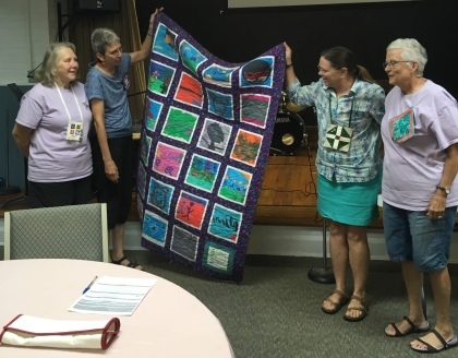 quilters with kids' art quilt