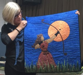 quilt with woman and bow and arrow