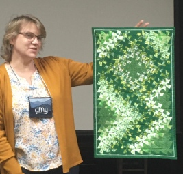 green quilted wall hanging